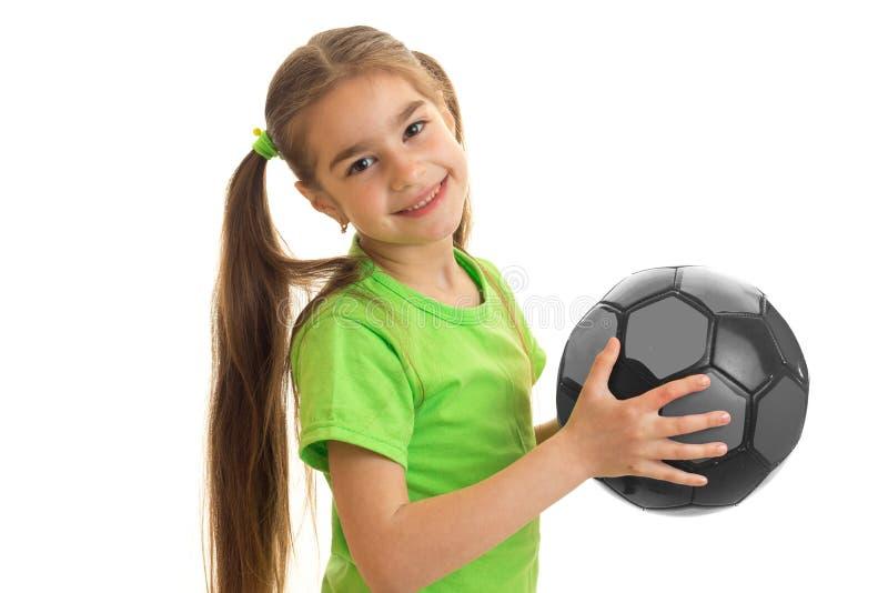 Ein strahlendes rebnok hält in ihrer Hand die Ballnahaufnahme lizenzfreies stockfoto
