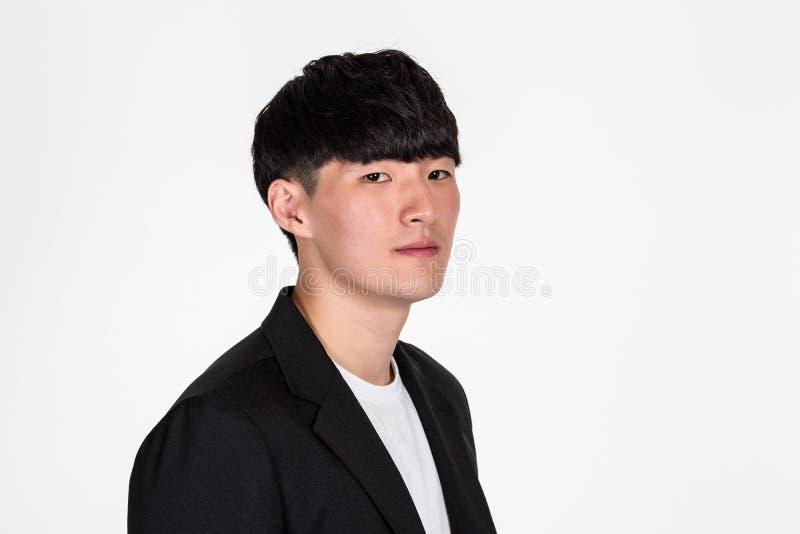 Ein Studioporträt eines asiatischen männlichen childaPortrait eines asiatischen Ostmannes in einer Studiospitze eines Geschäftsma lizenzfreie stockbilder