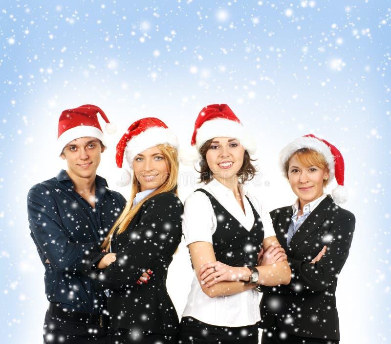 Ein Team der Geschäftspersonen in den Weihnachtshüten stockfotografie