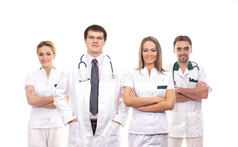 Ein Team der jungen medizinischen Arbeitskräfte in der weißen Kleidung lizenzfreies stockbild