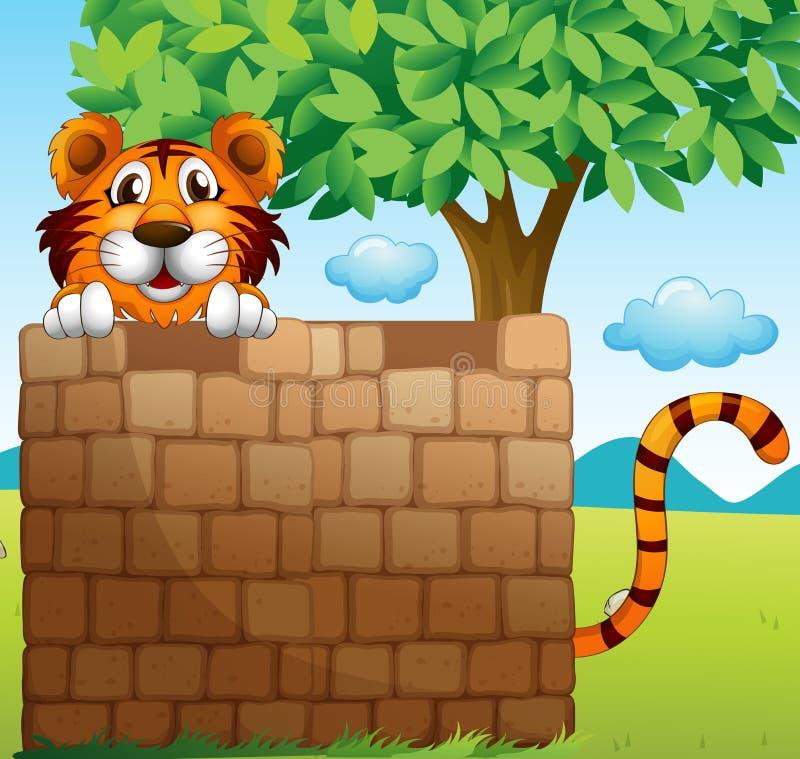 Ein Tiger, der auf einem Stapel von Ziegelsteinen sich versteckt stock abbildung