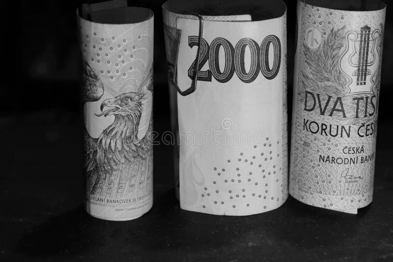 Ein tschechisches Schwarzweiss-Geld in den kleinen Rollen lizenzfreies stockfoto