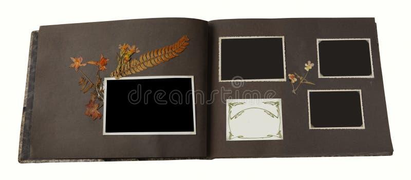 Ein Weinlesefotoalbum mit 4 leeren Bilderrahmen lizenzfreie stockfotografie