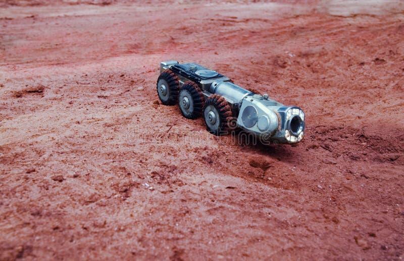 Ein wirkliches Sciencefictionsbild, eine Maschine auf Mars stockfotos