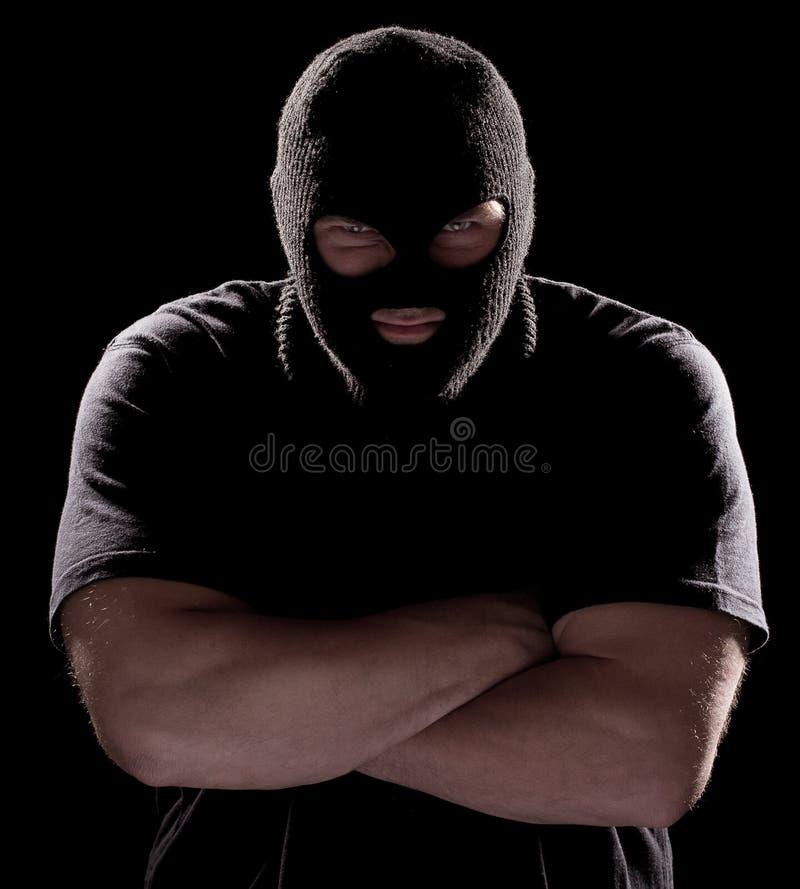 Einbrecher in der Schablone stockfotografie