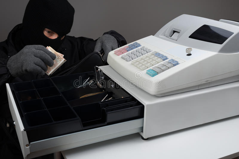 Einbrecher Stealing Money lizenzfreie stockfotos