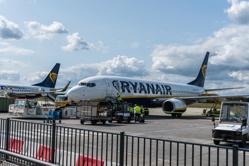 EINDHOVEN, THE NETHERLANDS - AUG 25, 2018: Ryanair aircraft on the runway. Ryanair is a major company for low cost royalty free stock photography