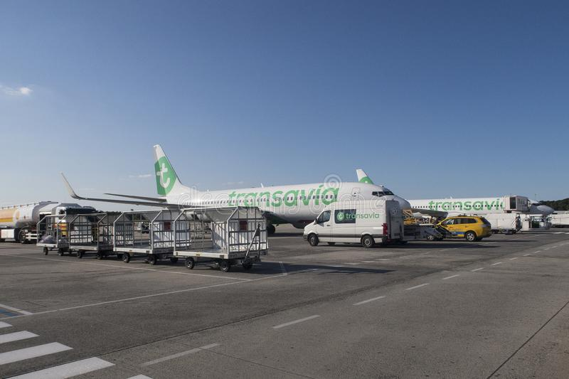 Airplane of Transavia getting ready for departure and boarding people from the airport of royalty free stock photos