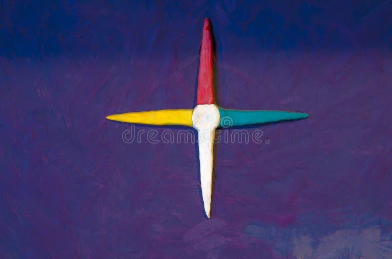 Eine abstrakte Zahl gemacht vom Plasticine, eine Windrose nachahmend lizenzfreie stockfotografie