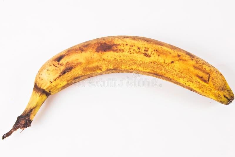 Eine alte Banane, die angefangen hat zu verfallen stockbilder
