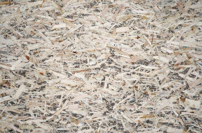 Eine alte OSB-Platte OSB, Holzfaserplattenhintergrund der Beschaffenheit Blatt wird von den braunen Holzspänen gemacht, die zusam stockfotografie