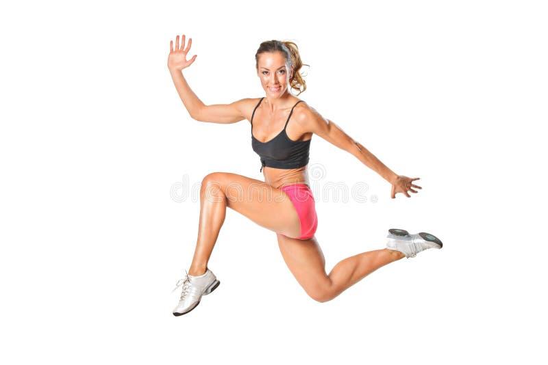 Eine attraktive Frau in einem Sprung stockfoto