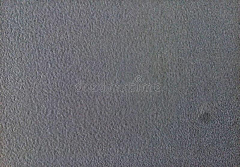 Eine befleckte Oberfläche einer grauen Farbwand stockfoto