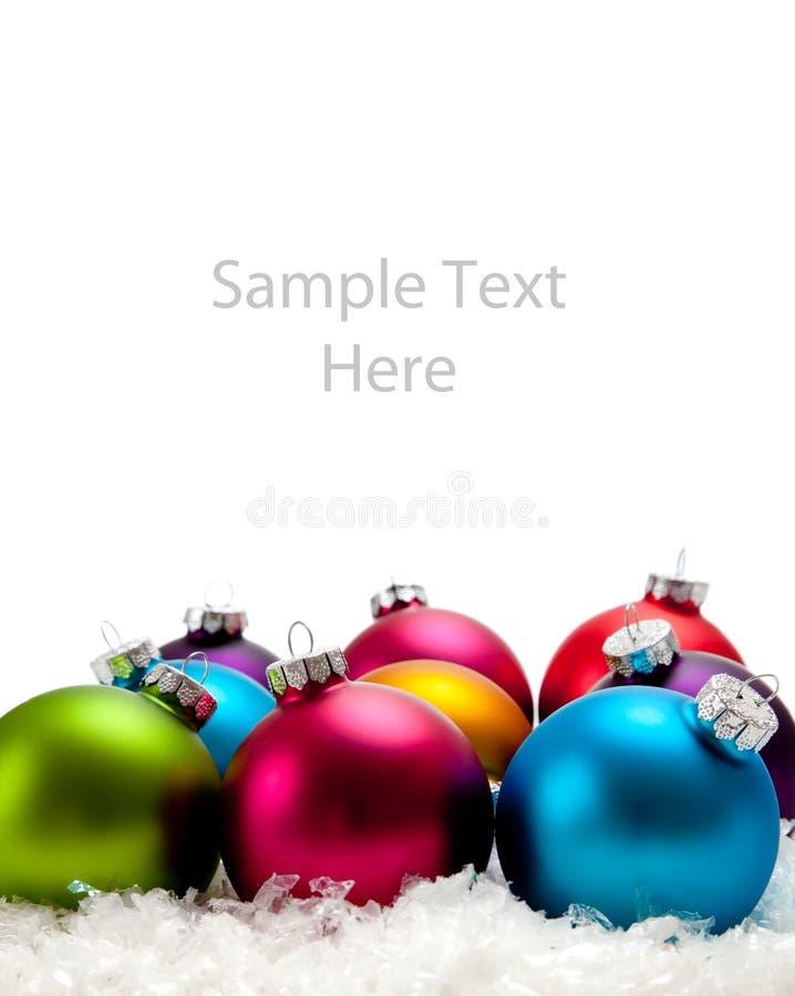 Eine blaue Weihnachtsverzierung/-flitter mit Exemplarplatz stockbild