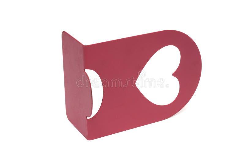 Eine einzelne rosarote Buchstütze mit einem Herzen formte Höhle lizenzfreie stockbilder