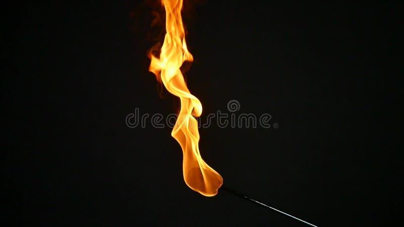 Eine Fackel für fireshow Brände, Zeitlupe stockbilder