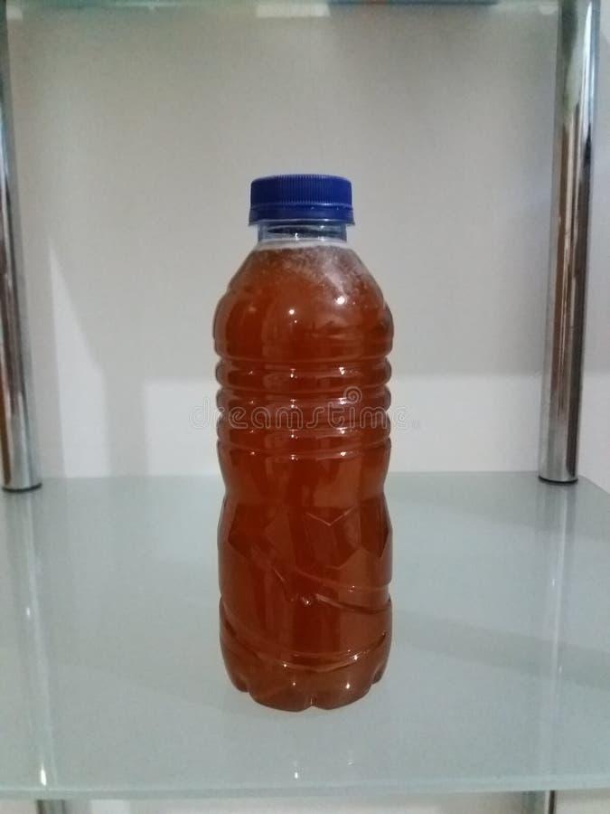 Eine Flasche Honig lizenzfreie stockfotografie