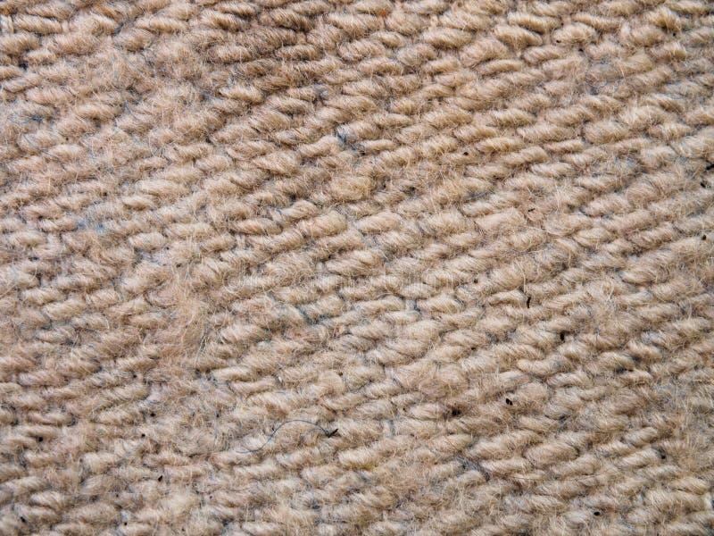 Eine Ganzseite des grauen synthetischen Fauxmaterials Makro graue Strickjacke, gestrickte Wollbeschaffenheit Ansicht der Spitze a lizenzfreie stockbilder