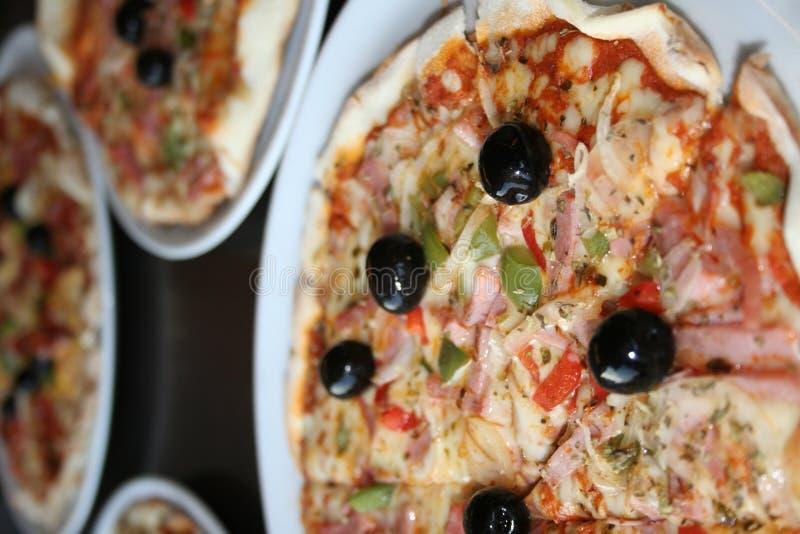 Eine geschmackvolle Pizza stockfotografie