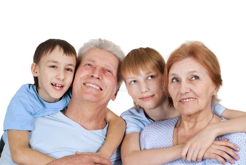 Download Eine Glückliche Vierköpfige Familie Stockfoto - Bild von kinder, enkelkinder: 26370434