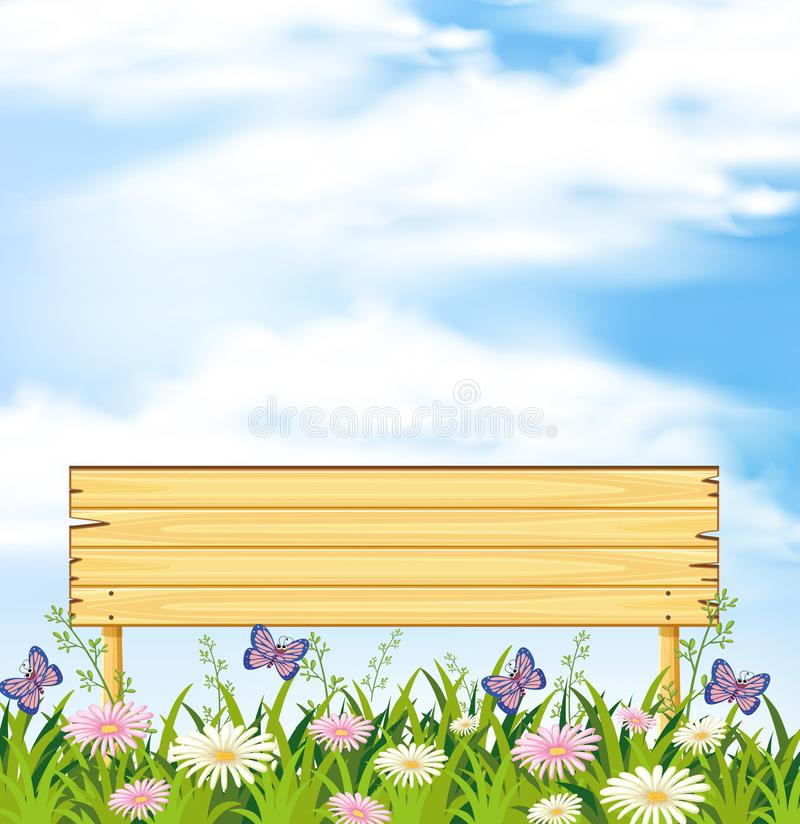 Eine hölzerne Fahne im Blumen-Garten lizenzfreie abbildung