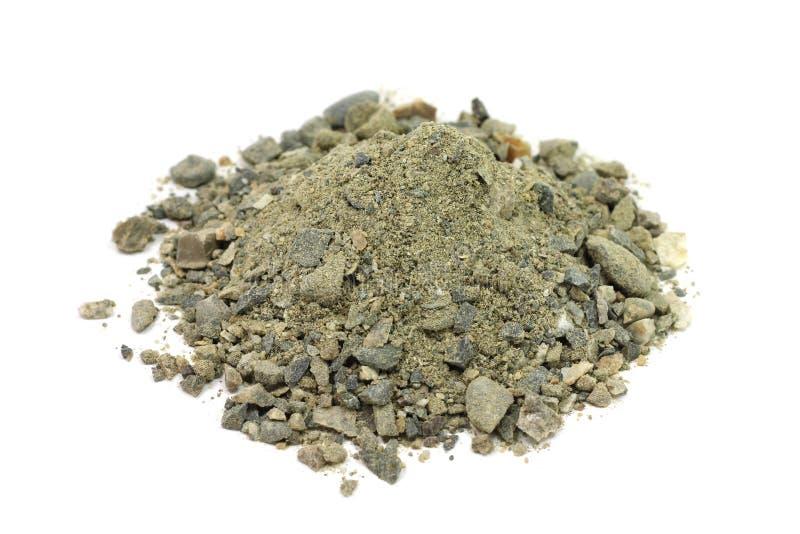 Eine Handvoll der Mischung des Sandes und des feinen Kieses lizenzfreies stockbild