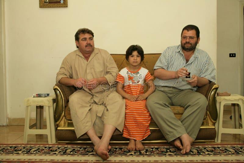 Eine irakische Flüchtlingsfamilie zu Hause, Cario stockfotos