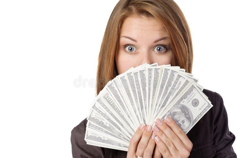 Eine junge Frau mit Dollar in ihren Händen lizenzfreie stockbilder