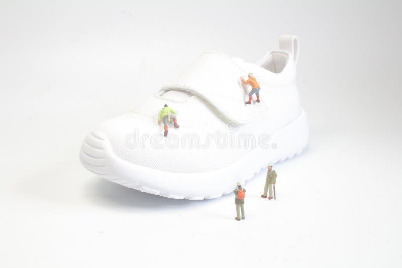 eine kleine Zahl Aufstieg des Spaßes die Schuhe stockbilder