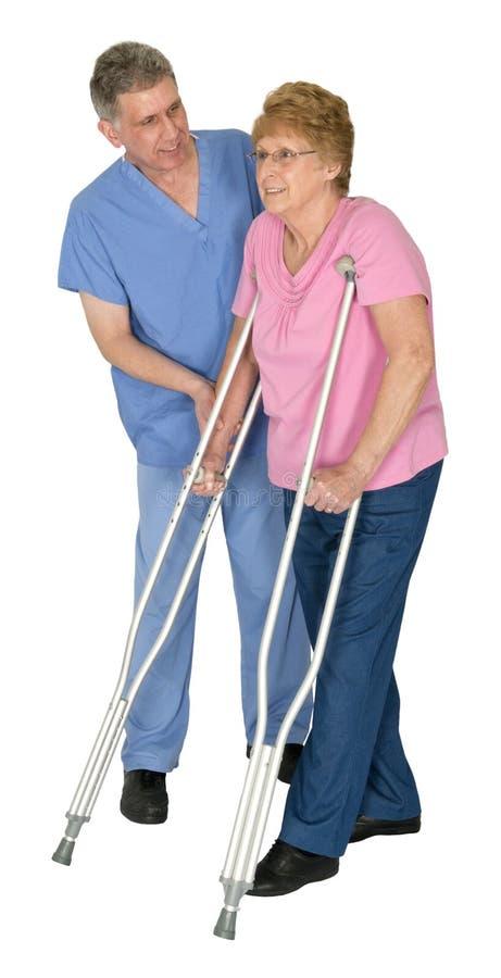 Krankenschwester, körperliche Therapie, reife ältere ältere Frau lizenzfreies stockbild