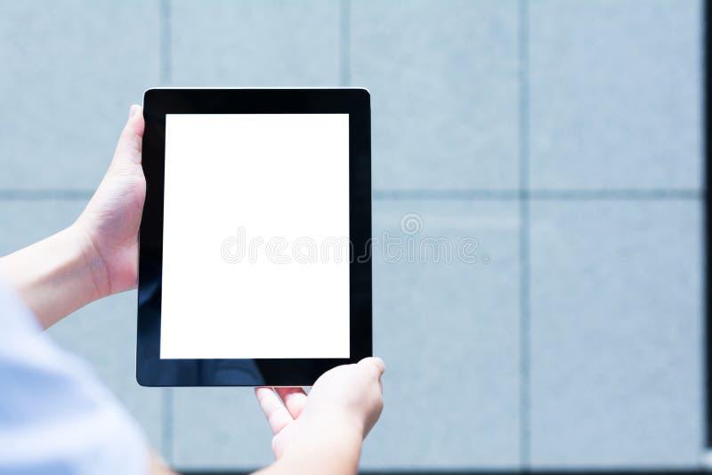 Eine Leute, die eine digitale Tablette verwenden stockfotografie