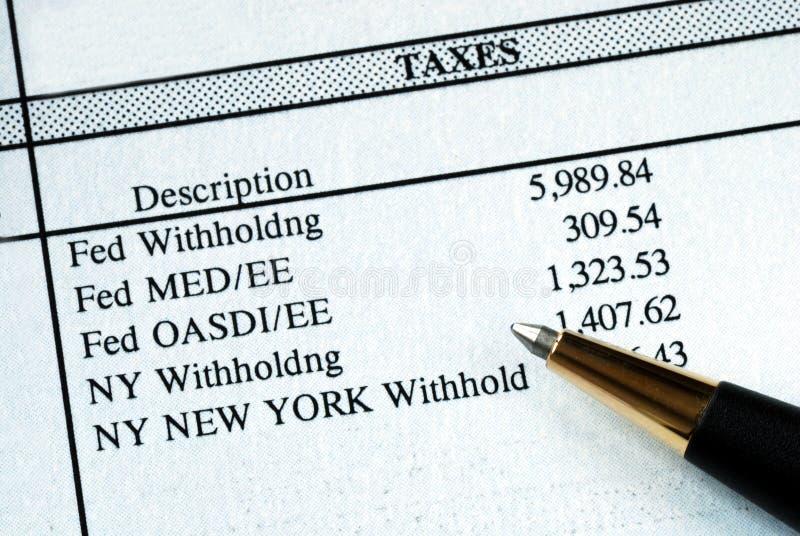 Eine Liste von Quellensteuern lizenzfreie stockfotografie