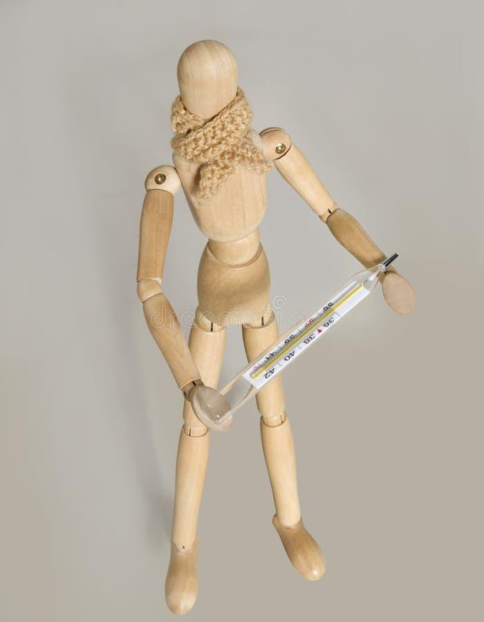 Eine Marionette mit Schal und Thermometer stockfotos
