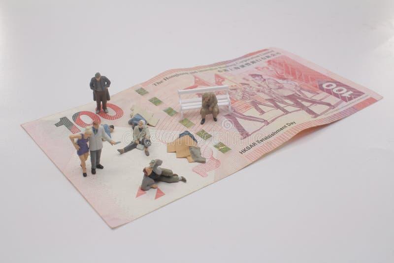 eine Minizahl von begger auf Banknote stockfotografie