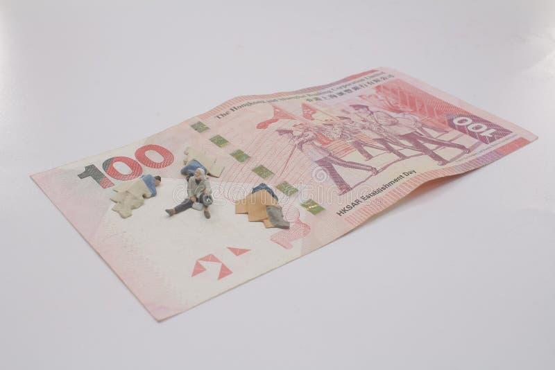 eine Minizahl von begger auf Banknote lizenzfreies stockfoto