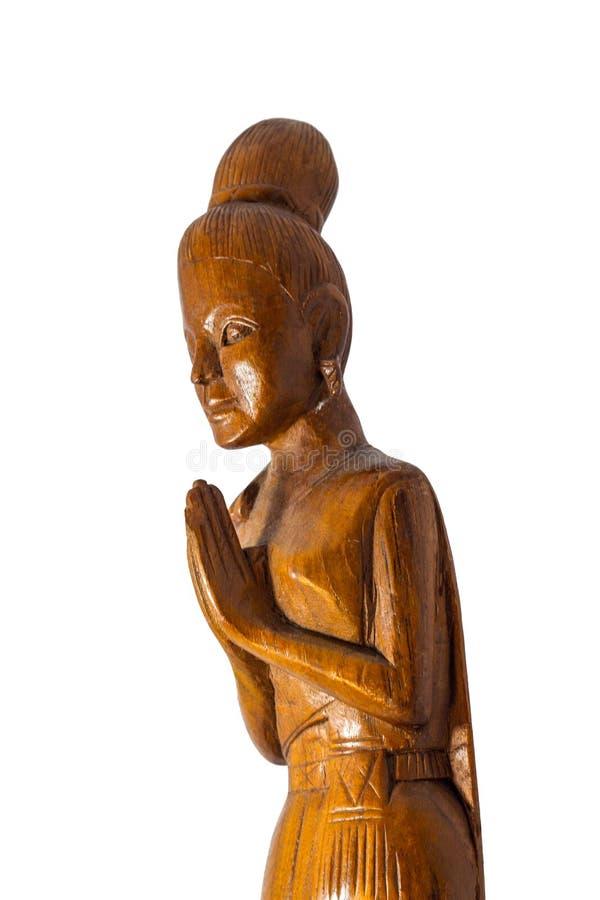 Eine Namaste-Puppenverbeugung von der Seite lizenzfreie stockfotografie