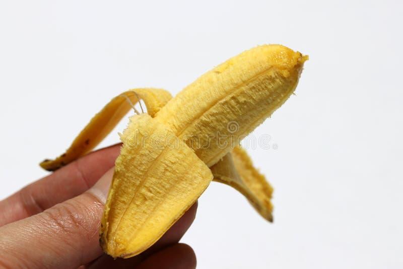 Eine pisang mas-Banane zog in der Hand auf den weißen Hintergrund ab stockbild