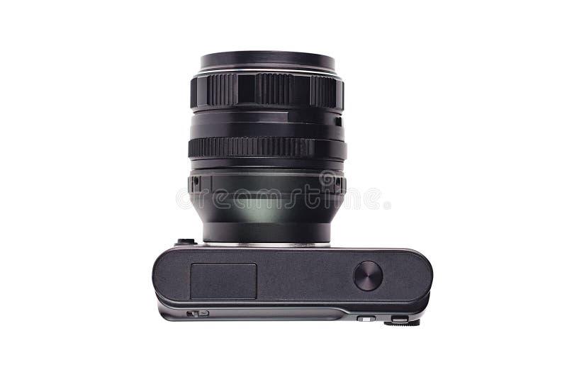 Eine professionelle digitale schwarze Kamera mit der Linse lokalisiert auf weißem Hintergrund Beschneidungspfad eingeschlossen stockfoto