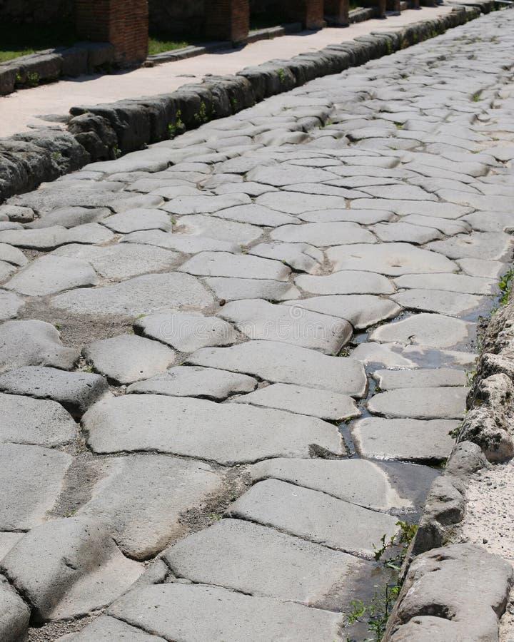 Eine Römerstraße innerhalb der Ruinen von Pompeji Italien stockfoto
