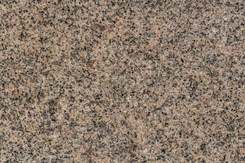 Eine schöne Beschaffenheit der natürlichen Steinoberfläche des grauen und gelben Granits im Foto stockbilder