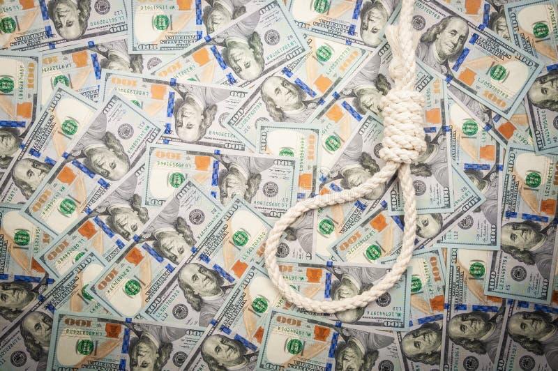 Eine Schleife des Seils auf Hintergrund von Dollar Draufsicht, Kopienraum lizenzfreie stockfotos