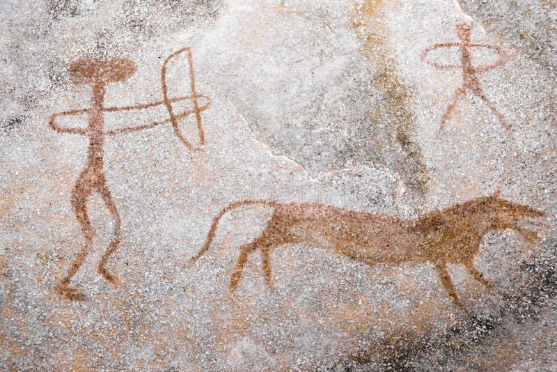 Eine Szene von Tierjagd führte ockerhaltiges auf der Wand der Höhle durch vektor abbildung
