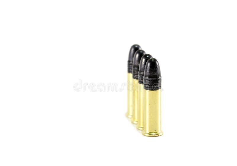 Eine Zeile der kleinen .22 Gewehrkugeln stockfotos