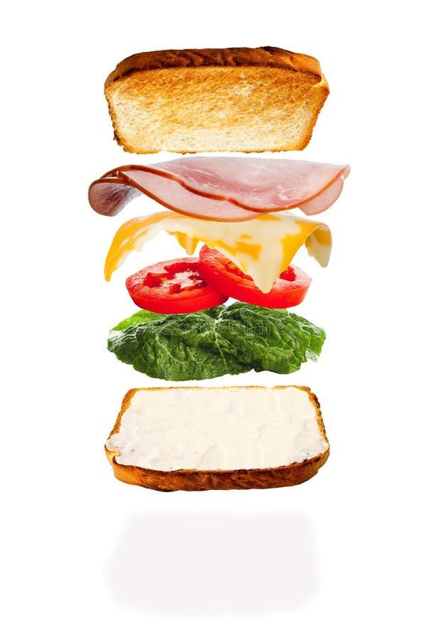 Einen Käse und Ham Sandwich zusammenfügen lizenzfreie stockfotos