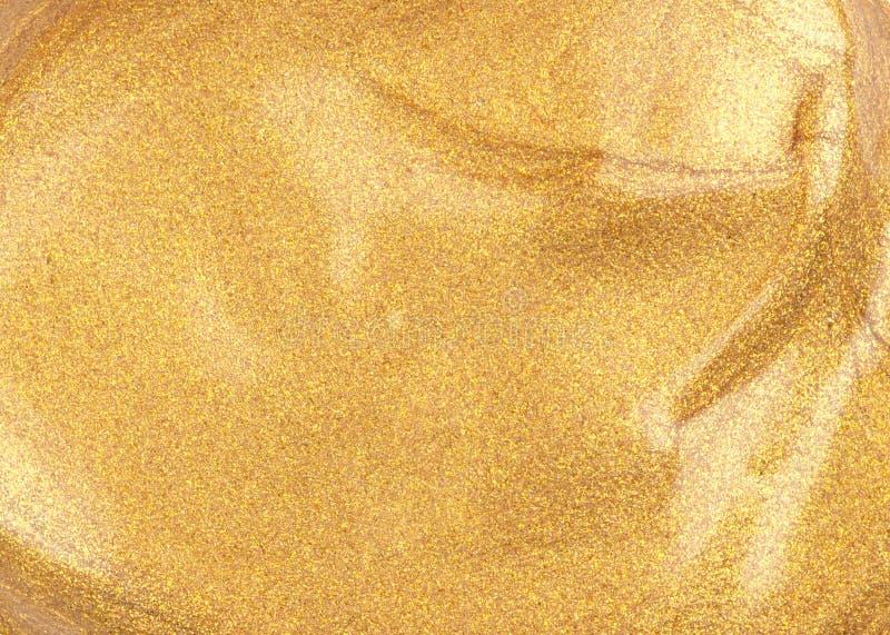 Einfache Probe der flüssigen goldenen Grundlage des Gesichtsmakes-up; mit Funkelnpartikeln stockbild