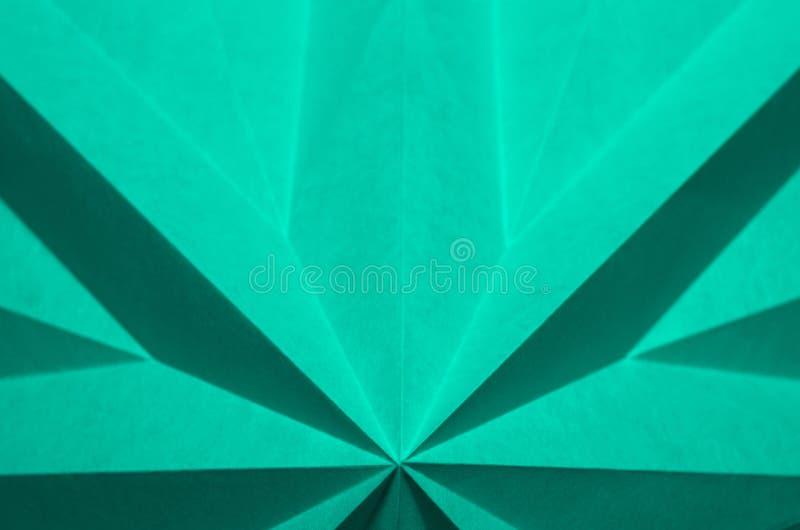 Einfacher einfarbiger abstrakter Hintergrund vom Origami stockfotos