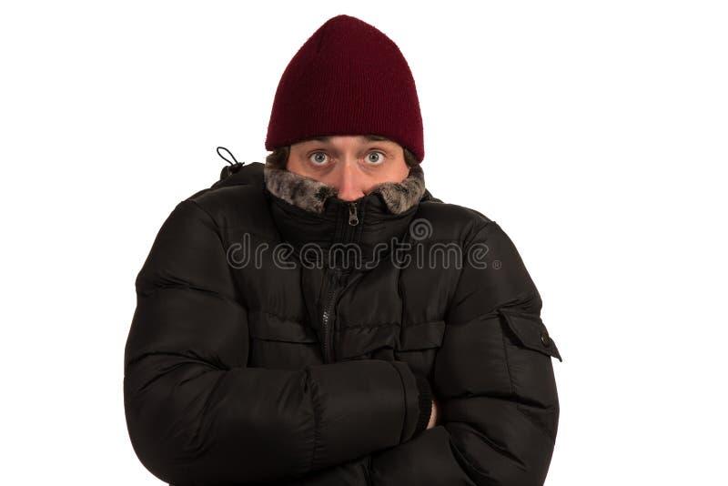 Einfrieren des jungen Mannes stockbild