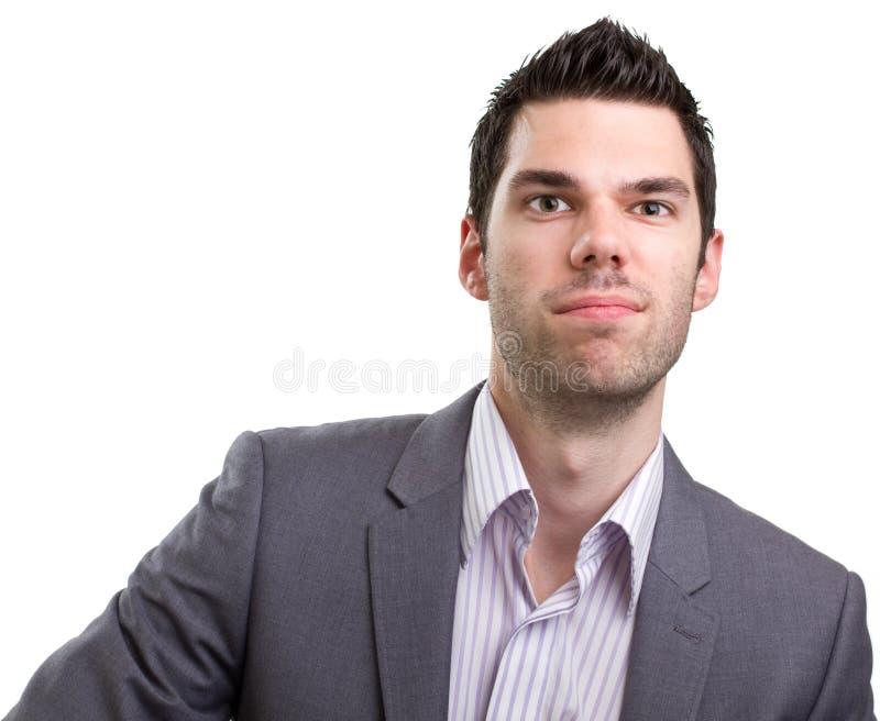 Eingebildeter junger entsprochener Mann stockfotografie
