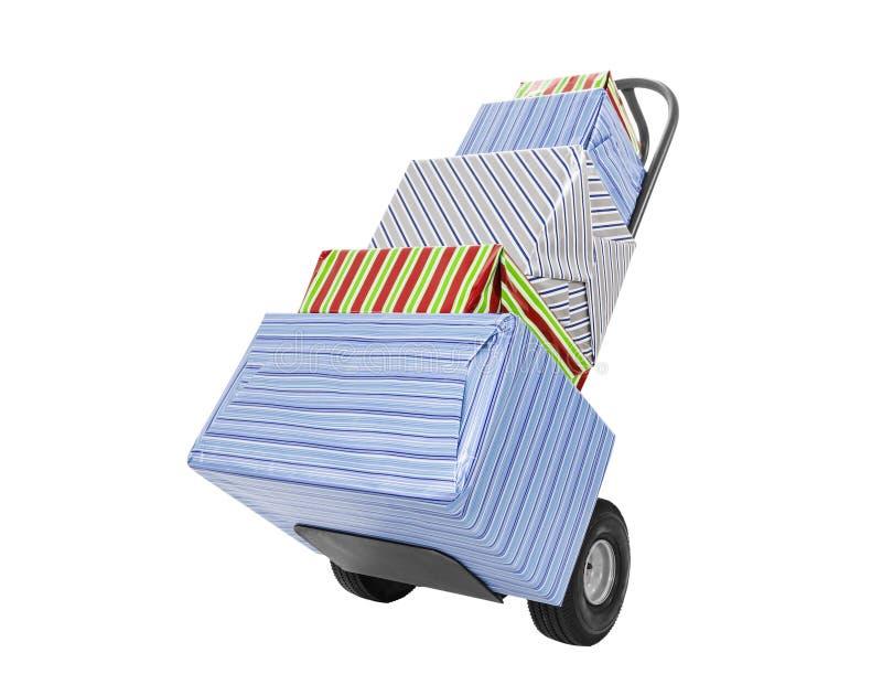 Eingewickelte Geschenke auf Möbel-Transportwagen stockbilder