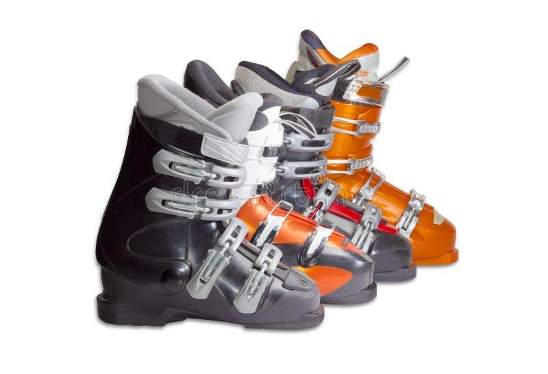 Einige alpine Skischuhe auf einem hellen Hintergrund lizenzfreie stockfotografie